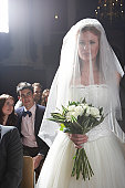 Bride walking down aisle, smiling