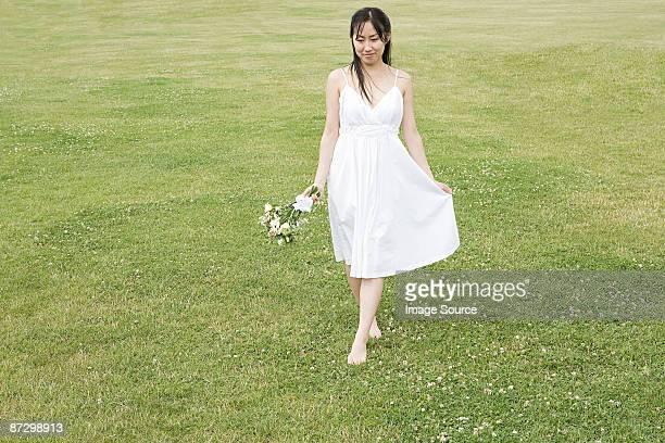 Bride walking on grass