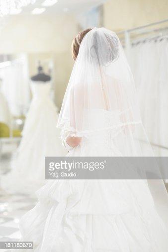 Bride wearing bridal dress in bridal wear store