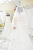 Bride wearing bridal dress in bridal wear store