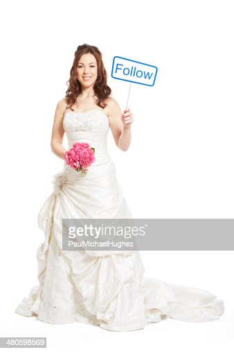 Bride wearing wedding dress holding a social media sign : Stock Photo