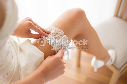 Bride Wearing Wedding Garter On Leg Stock Photo