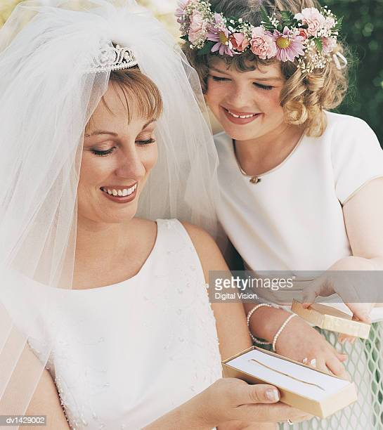Bride With a Bridesmaid Opening a Gift