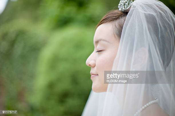 Bride with eyes closed, side view