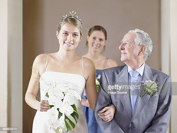 Bride with father and bridesmaid