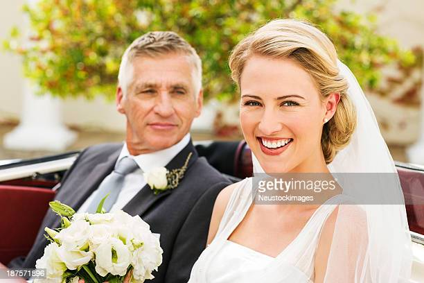 Bride With Father Looking At Her In Convertible Car