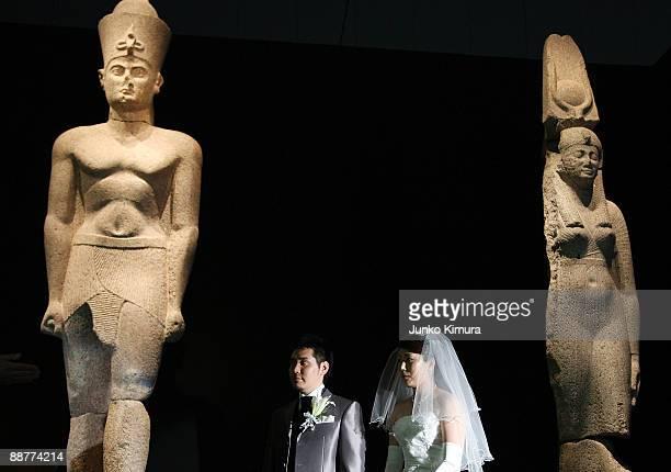 Bride Yuriko Kasuya and Groom Junya Kuramoto attend their Egyptianthemed wedding ceremony in front of 5meter high statues Hapy god of Nile Pharaoh...