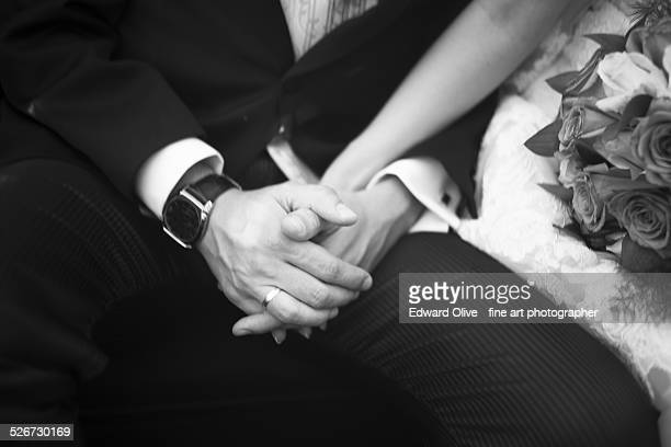 Bridegroom and bride in wedding holding hands
