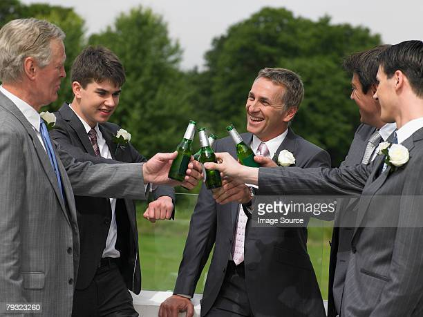 Bridegroom best man and ushers toasting