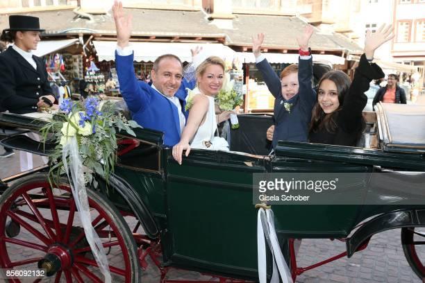 Bridegroom Erdogan Atalay and his bride Katja Ohneck with Amira 'Pauletta' Pollmann daughter of Erdogan Atalay and Maris Atalay son of Erdogan and...
