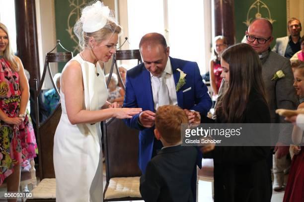 Bridegroom Erdogan Atalay and his wife Katja Ohneck and their children Amira 'Pauletta' Pollmann and Maris Atalay during their civil wedding on...