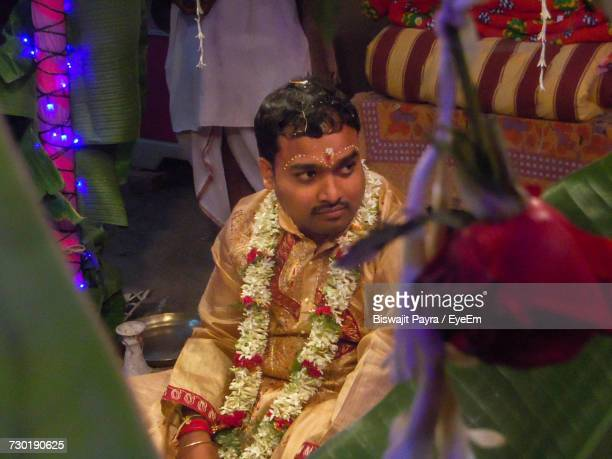 Bridegroom Looking Away During Wedding Ceremony