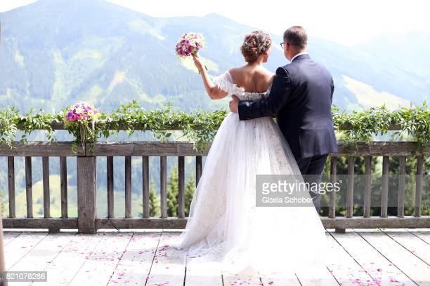 Bridegroom Torsten Koch and his wife bride Annika Koch during the wedding of Torsten Koch and Annika Hofmann at Wiesergut Alm on July 22 2017 in...