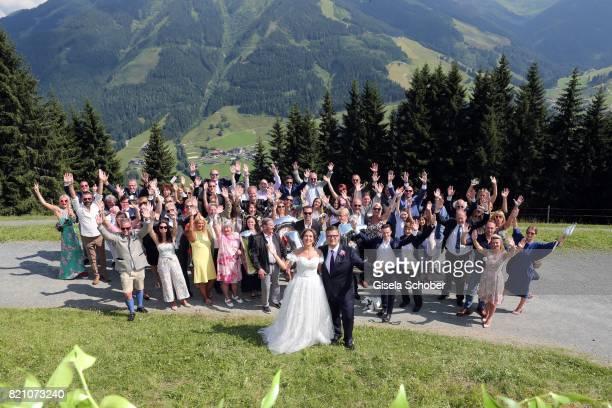 Bridegroom Torsten Koch and his wife bride Annika Koch with guests during the wedding of Torsten Koch and Annika Hofmann at Wiesergut Alm on July 22...