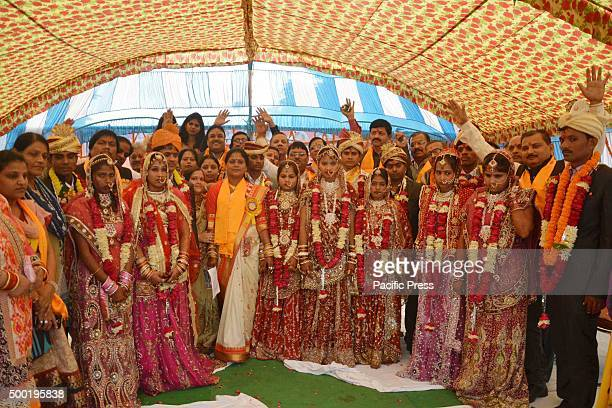 Brides and grooms during a mass wedding ceremony organized by Panchal Bharmand community in Allahabad