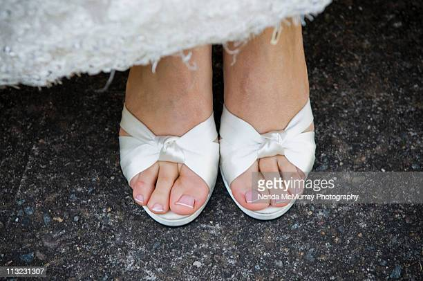 Bride's feet white shoes