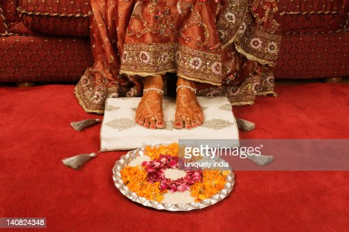 Indian female feet stock photos and pictures getty images for Aarti thali decoration with rice
