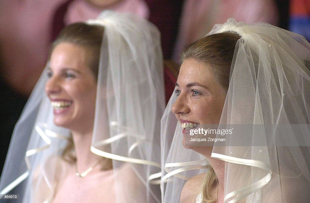 Brides Tijana Schouten, left, and Ilonka Brouwer smile during their wedding ceremony April 27, 2001 in The Hague, The Netherlands. The Netherlands are the first country to allow gay couples to get married.