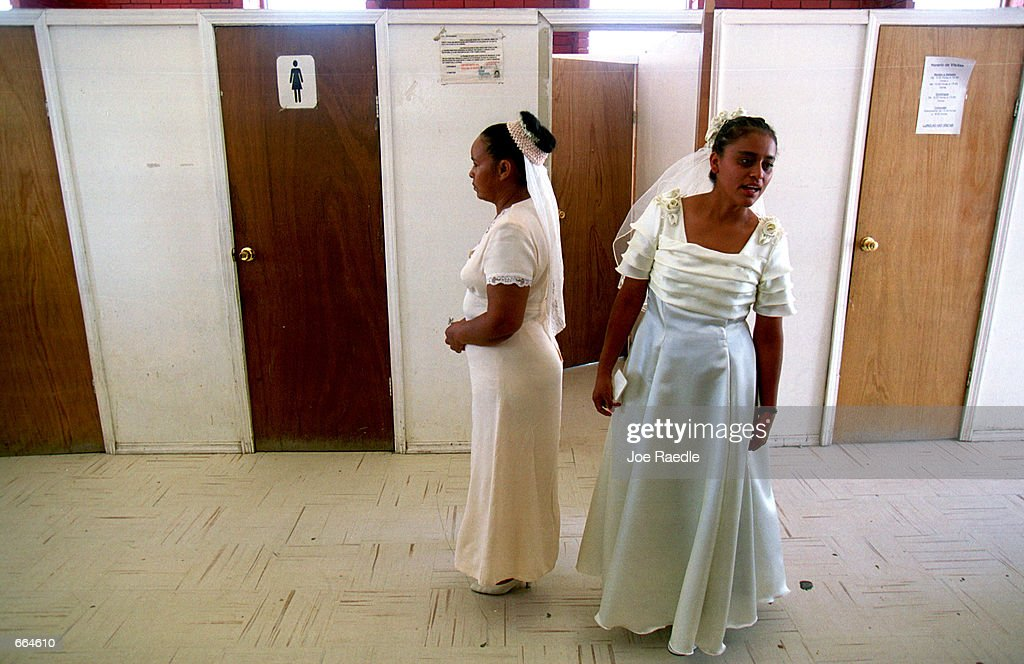 Brides wait to be searched in private rooms as they enter a prison October 2, 2000 in Ciudad Juarez, Mexico. Mexican law allows for inmates to marry inside prison walls. 5 couples, one current inmate and four former inmates were married by their church pastor.