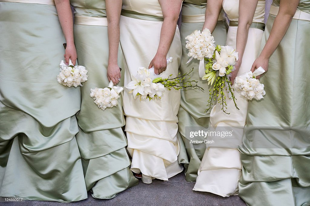 Bridesmaids and bouquets : Stock Photo
