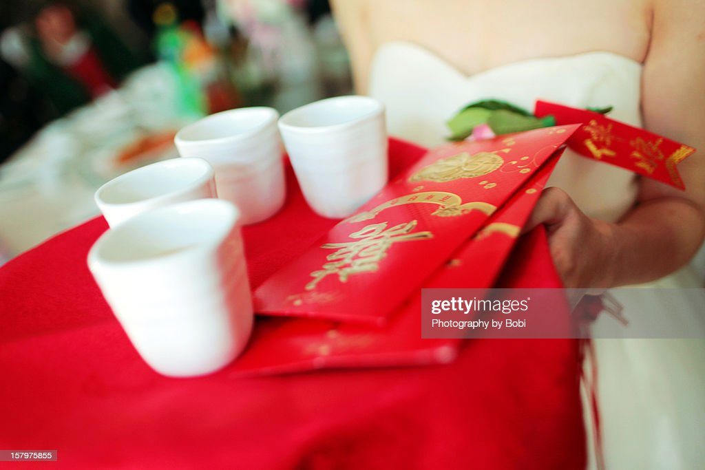 Bridesmaids and red envelope of Chinese wedding : Stock Photo