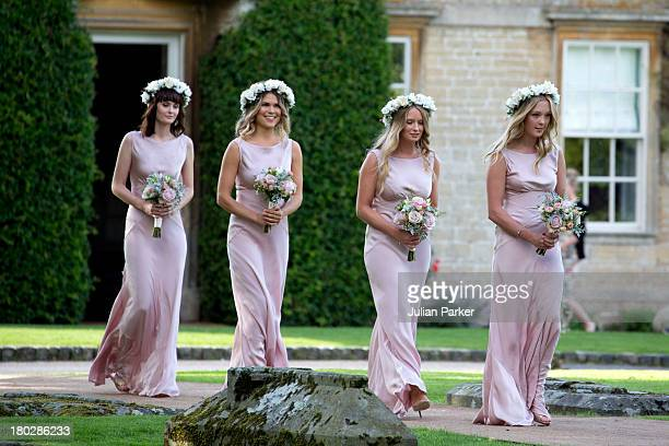 Bridesmaids arrive for the wedding of Millie Mackintosh and Professor Green at Babington House on September 10 2013 in Frome England