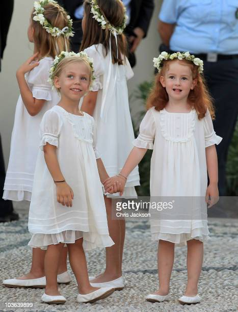 Bridesmaids arrive for the wedding of Prince Nikolaos and Miss Tatiana Blatnik at the Cathedral of Ayios Nikolaos on August 25 2010 in Spetses Greece...