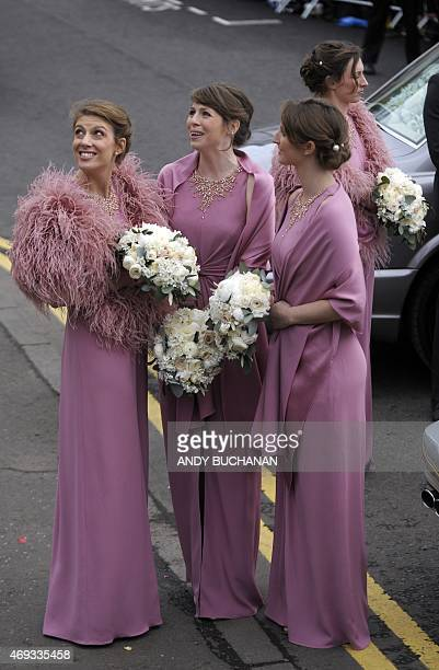 Bridesmaids look up at the wedding of British tennis player Andy Murray and his new wife Kim Sears at Dunblane Cathedral in Dunblane on April 11 2015...