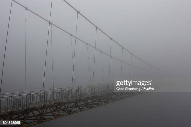 Bridge Against Sky During Foggy Weather