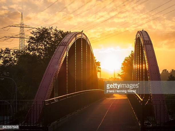 Bridge and rising sun