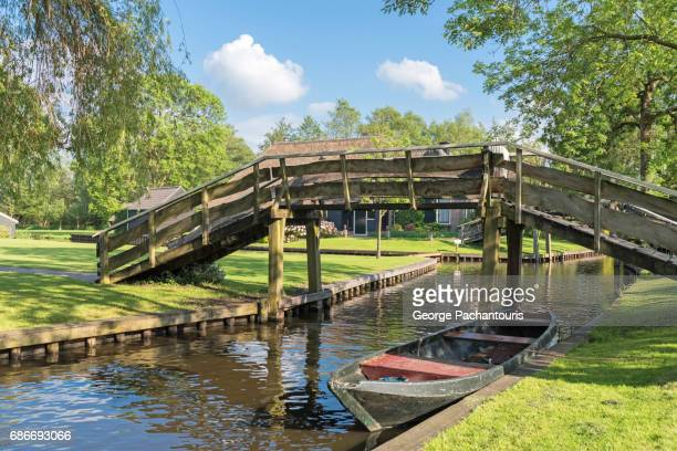 Bridge and tourist boat in Giethoorn, Netherlands