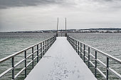 Bridge at lake in winter with snow on it
