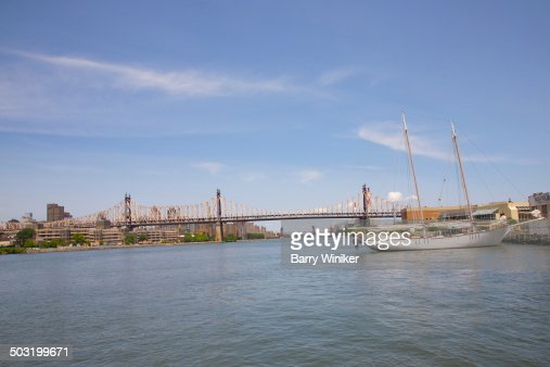 Bridge, boat and East River near Queens