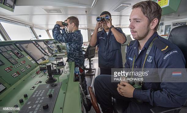 Bridge crewmen aboard the Dutch ship HNLMS Johan de Witt including a US Navy Officer on loan for the NATO exercise perform their duties during Bold...