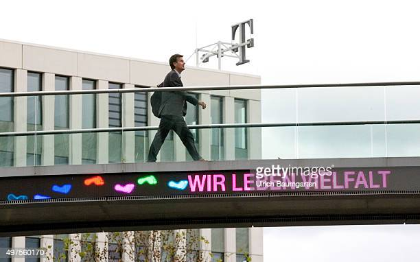 Bridge crossing between the buildings of the Telekom headquarters in Bonn with the neon sign WE LIVE DIVERSITY