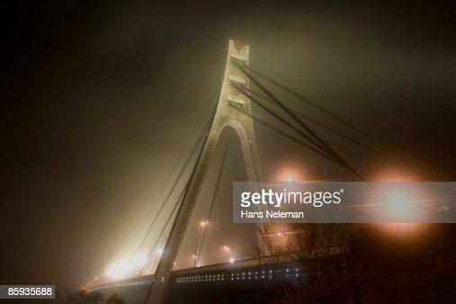 Bridge in the fog, over the Dnieper River : Stock Photo
