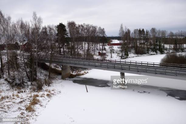 A bridge over a frozen river along the OsloBergen train route on March 04 2017