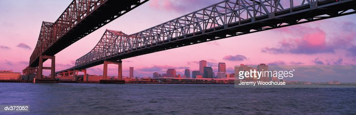 Bridge over Mississippi River, New Orleans in background : Stock Photo