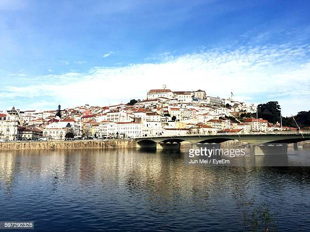 Bridge Over Mondego River Against Blue Sky