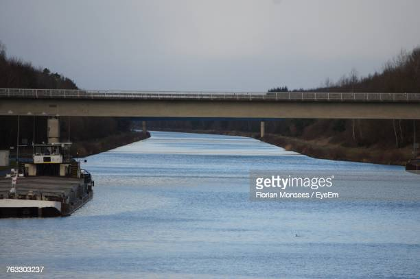 Bridge Over River Against Clear Sky During Winter