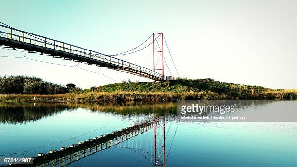Bridge Over River Against Clear Sky