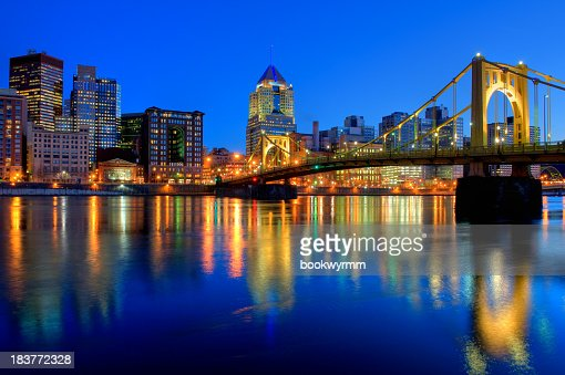 Bridge over River in Pittsburgh at night with city view