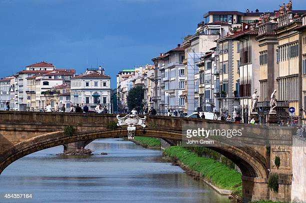 Bridge over the Arno River and downtown architecture