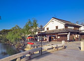 Bridge over the river and houses in Kurashiki,  Okayama Prefecture,  Japan