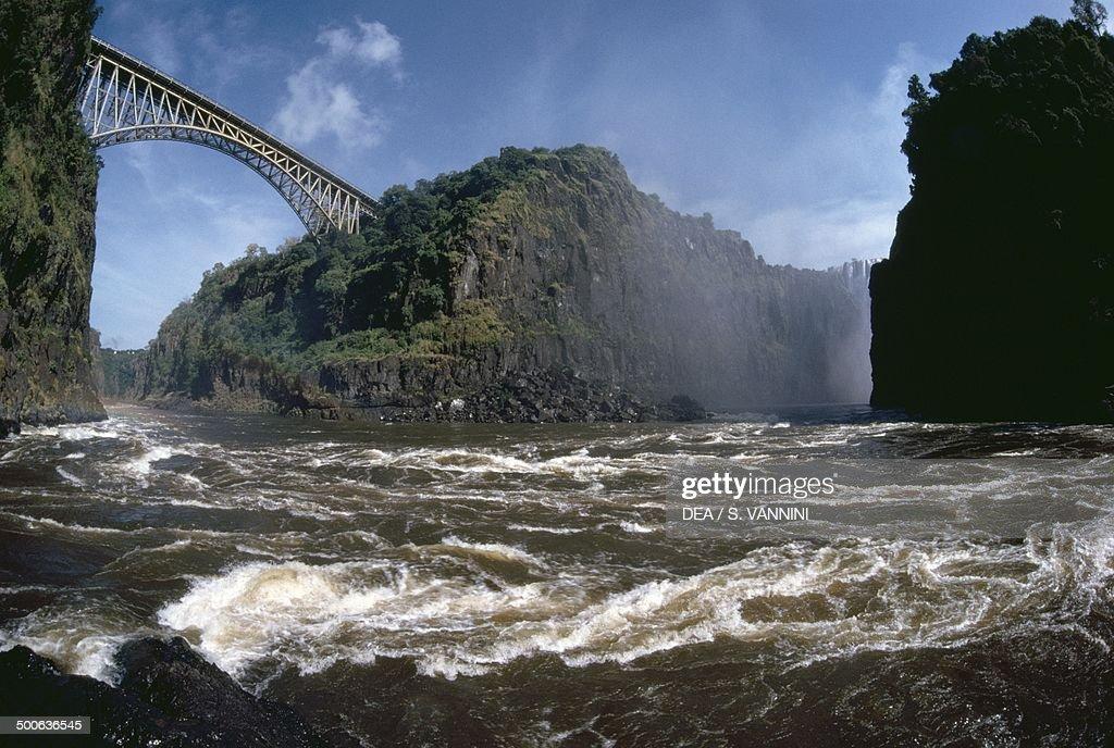 Bridge over the Zambezi River lagoon known as the Boiling Pot MosioaTunya National Park Victoria Falls Zambia