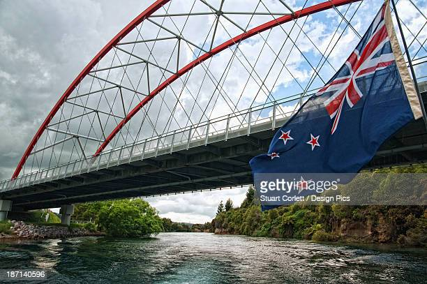 Bridge Over Waikato River With The New Zealand Flag