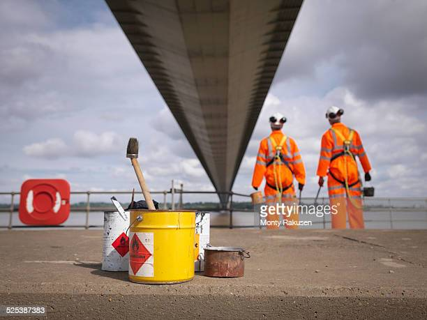 Bridge painters looking at suspension bridge. The Humber Bridge, UK was built in 1981 and at the time was the worlds largest single-span suspension bridge