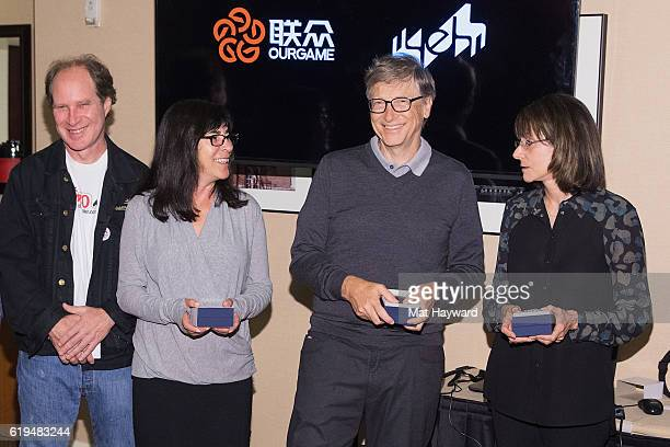 Bridge Players Fred Gitelman Sheri Winestock Bill Gates and Sharon Osberg pose for a photo before playing the first live Yeh Online Bridge World Cup...