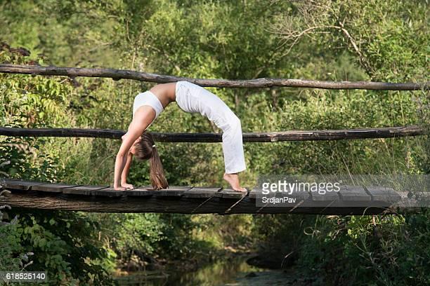Bridge pose on the bridge