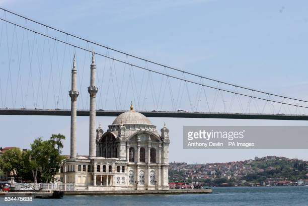 A bridge spans the Bosphorus Strait in Istanbul the largest shipping channel in the world which separates the continents of Europe and Asia Republic...